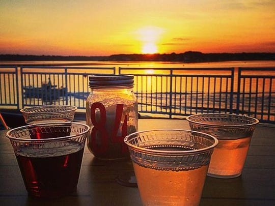 Enjoy a drink while watching the sun set over Shark River Hills.