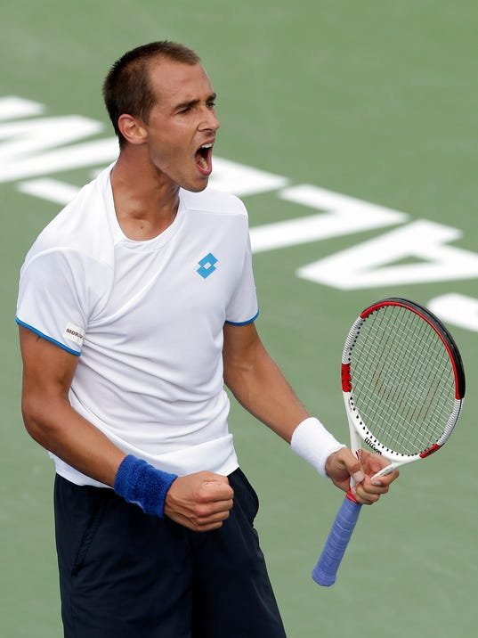 Lukas Rosol, of Czech Republic, reacts after defeating Yen-Hsun Lu, of Taiwan, in their semi-final match at the Winston-Salem Open tennis tournament in Winston-Salem, N.C., Friday, Aug. 22, 2014. Rosol defeated Lu 7-5, 4-6, 6-4. (AP Photo/Chuck Burton)