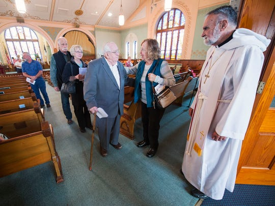 The Rev. Gene Edwards greets people after worship Sunday at Trinity (Roth's) United Church of Christ in Jackson Township. Trinity celebrated 250 years in 2015.