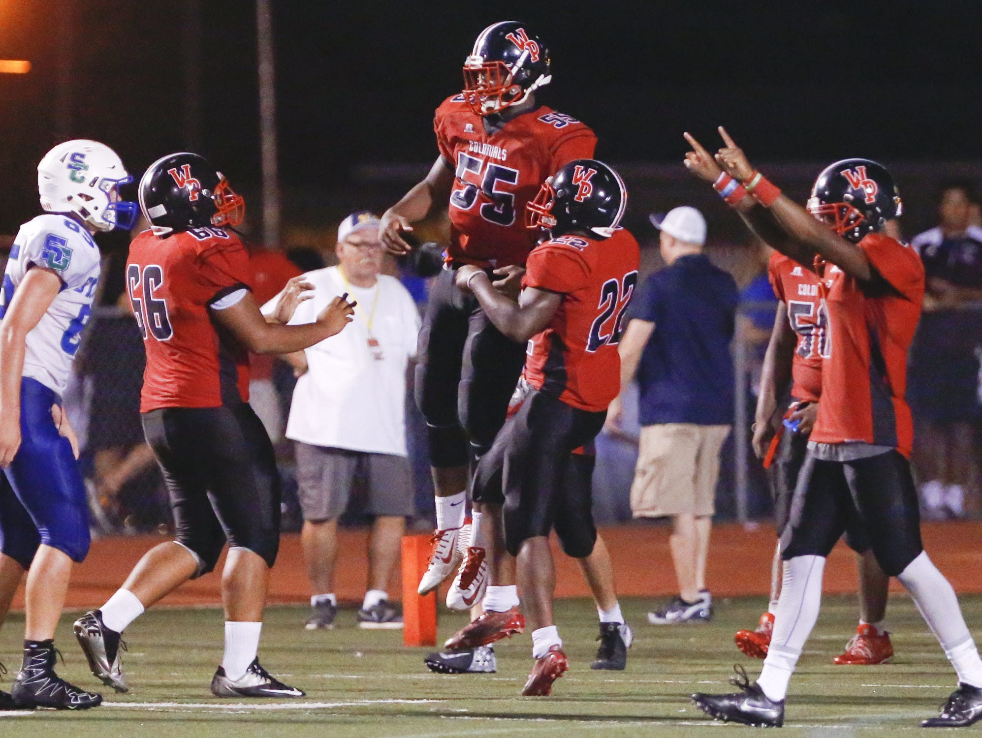 The William Penn defense celebrates a fumble return for a touchdown by Charles Hope (55), a huge play in the Colonials' 27-24 victory over St. Georges last Friday.