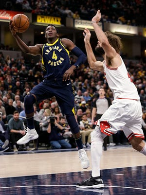 Indiana Pacers guard Victor Oladipo (4) shoots in front of Chicago Bulls center Robin Lopez during the second half of an NBA basketball game in Indianapolis, Saturday, Jan. 6, 2018. The Pacers won 125-86.
