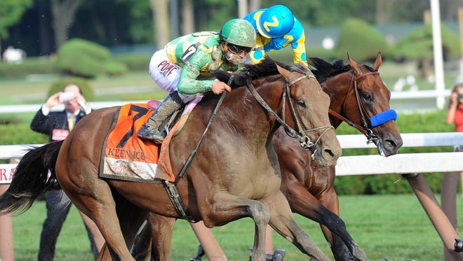 Keen Ice (7), with jockey Javier Castellano, moves past Triple Crown winner American Pharoah, with Victor Espinoza, to win the Travers Stakes.