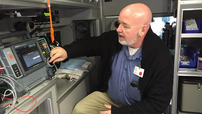 Chris Fry, an ambulance supervisor at Baxter Regional Medical Center, demonstrates how his team would monitor a hypothermic patient's heart through LIFEPAK 15. Hypothermia slows down a patient's heart rate.