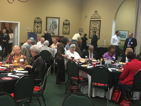 ADP members and guests enjoy breakfast at the organization's First Friday meeting.
