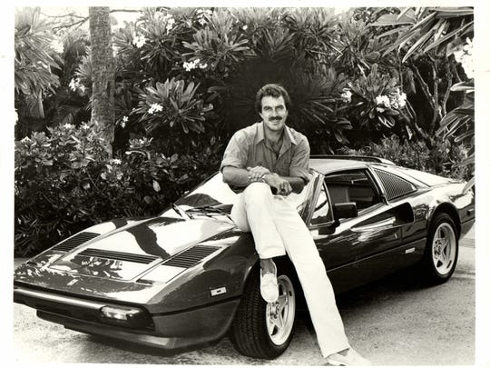 """Detroit native Tom Selleck, star of """"Magnum P.I."""" is all smiles as he poses next to a Maserati in 1985. The TV show ran on CBS from 1980 to 1988."""