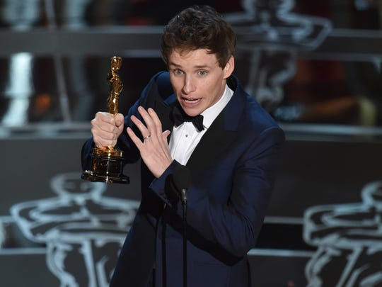 "Eddie Redmayne accepts the award for best actor in a leading role for ""The Theory of Everything"" at the Oscars on Sunday, Feb. 22, 2015, at the Dolby Theatre in Los Angeles. (Photo by John Shearer/Invision/AP)"