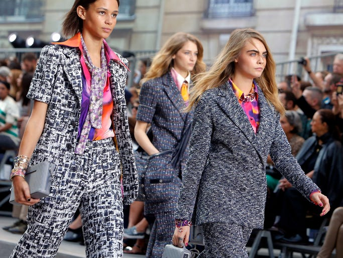 Model Cara Delavingne, right,  and other models wear creations as part of Chanel's Spring/Summer 2015 ready-to-wear fashion collection presented in Paris Tuesday, Sept. 30, 2014.
