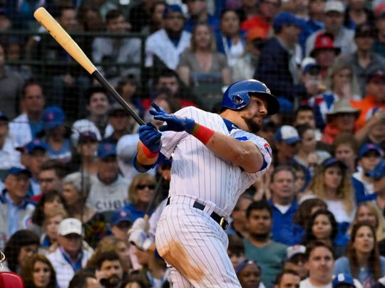 Chicago Cubs' Kyle Schwarber (12) hits a two-RBI double during the fifth inning of a baseball game against the St. Louis Cardinals, Sunday, June 9, 2019, in Chicago. (AP Photo/Matt Marton)