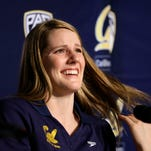 University of California freshman swimmer Missy Franklin smiles during a news conference  Aug. 28, 2013, in Berkeley, Calif.