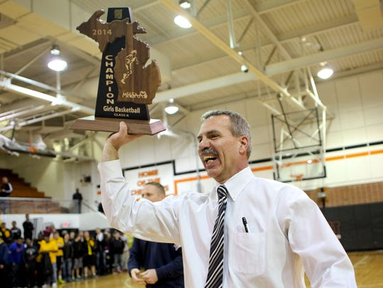 Port Huron Northern head coach Mark Dickinson holds