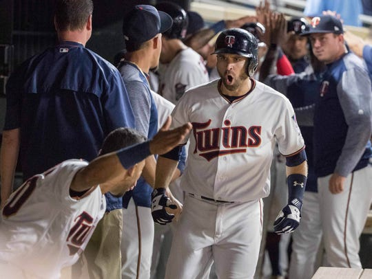 Minnesota Twins second baseman Brian Dozier (2) reacts