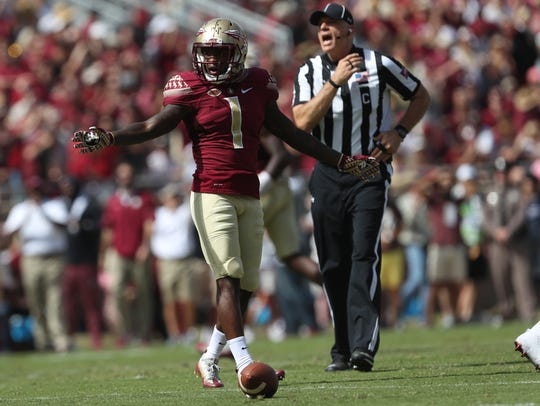 FSU's Levonta Taylor defends a pass against Louisville