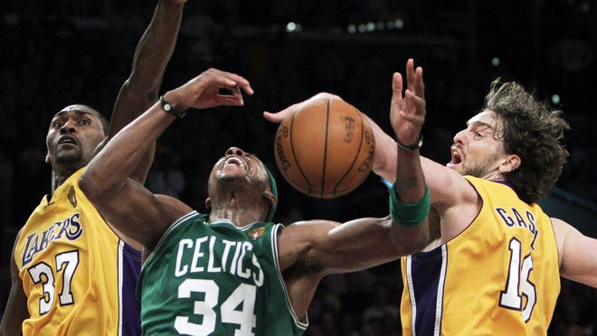 Los Angeles Lakers forward Pau Gasol, right, blocks a shot by Celtics forward Paul Pierce as Lakers' Ron Artest defends during the second half of Game 7 of the NBA basketball finals June 17, 2010 in Los Angeles. The Lakers won 83-79 to take the title. Pierce has thought about that loss every day for the last 10 years.