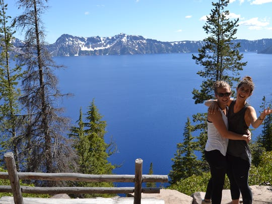 Alisha Roemeling and Emilie Hartvig stop for a photo at one of the many benches along the Cleetwood Cove Trail at Crater Lake.