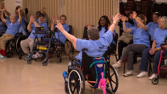 """Judith Mangum, a resident of Transcendent North Healthcare, starts off the Warrick County Southwest Indiana Regional Council on Aging (SWIRCA) Assisted Living and Nursing Home Games with """"The Wave"""" at the Chandler Community Center Wednesday morning."""