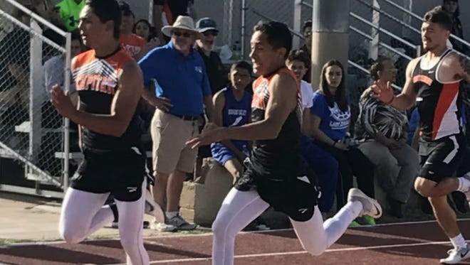 Capitan High's Jacob Smith and Alejandro Trujillo tie with a state qualifying time of :11.44 in the 100 m dash at the Grizzly Relays in Carrizozo April 6.