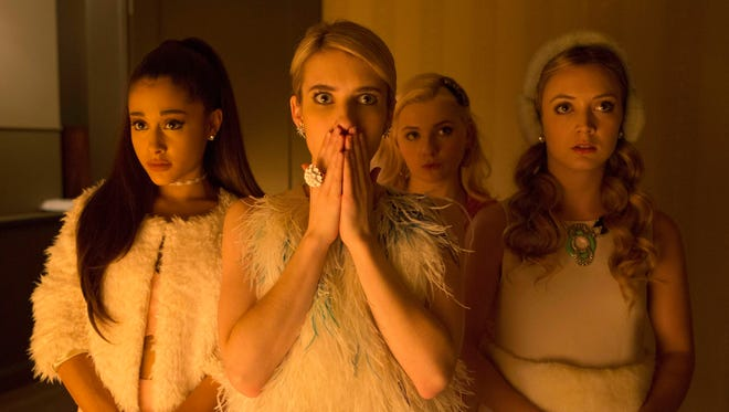 Emma Roberts, with Ariana Grande to her left, plays the head of a sorority in Fox's 'Scream Queens.""