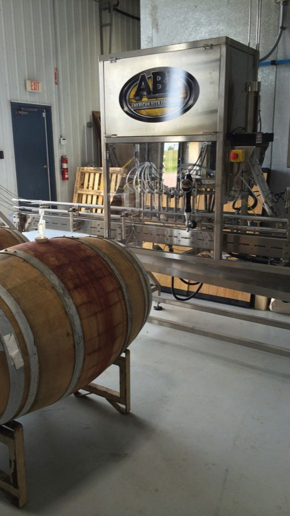 Canning equipment and barrels for aging at Fernson Brewing Co.
