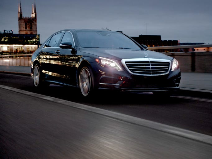 A scene from one of two launch ads for the redone 2014 Mercedes-Benz S-Class -- a moody nightscape ad that highlights the new car's luxury features.