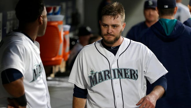 Seattle Mariners starting pitcher Wade Miley walks in the dugout after he was pulled in the seventh inning of a baseball game against the Chicago White Sox, Tuesday, July 19, 2016, in Seattle. The White Sox beat the Mariners 6-1. (AP Photo/Ted S. Warren)