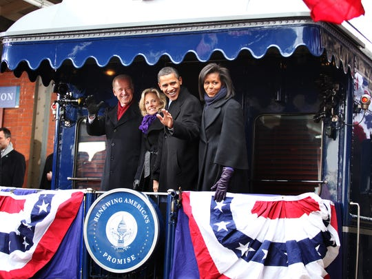 011709-WHISTLESTOP-RS President-elect Barack Obama and Vice President-elect Joe Biden and their spouses wave to the media in Wilmington, Del., Saturday, Jan. 17, 2009 during the historical Inaugural whistle stop train tour to Washington.