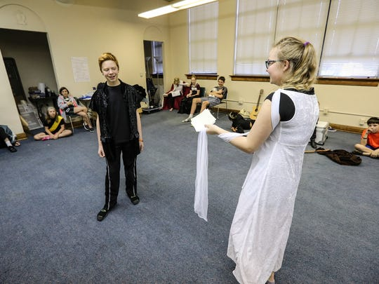 Jackson Baltes, left, and Emma Watson, right, perform a scene from Hamlet at the Clifton Center.  The performance was part of Kentucky Shakespeare camp.June 30, 2016