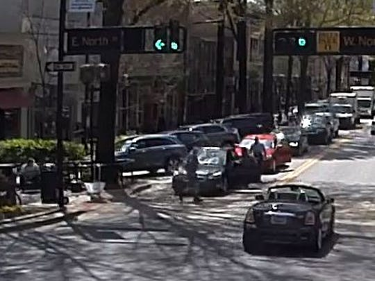 Surveillance video from the Greenville Police Department shows an attempted carjacking in downtown Greenville.