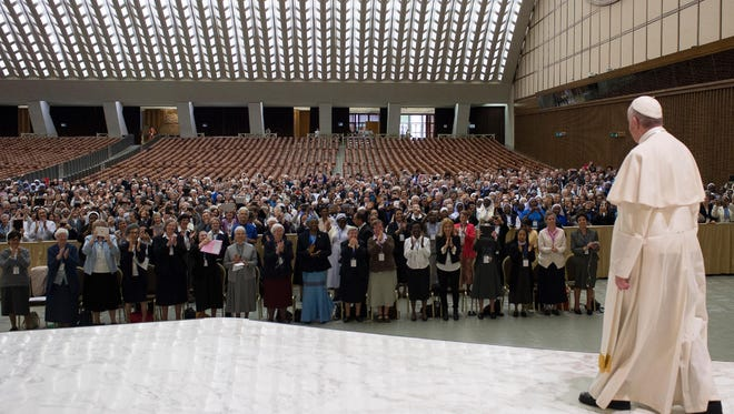 Pope Francis arrives for a special audience with Superiors General of Institutes of Catholic Women Religious in the Paul VI Hall at the Vatican, Thursday, May 12, 2016. Pope Francis said Thursday he is willing to create a commission to study whether women can be deacons in the Catholic Church, signaling an openness to letting women serve in ordained ministry currently reserved to men.  (L'Osservatore Romano/Pool photo via AP)