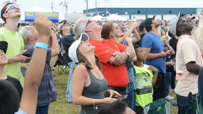 Spectators watch as The United States Navy Blue Angels Flight Demonstration Squadron flies overhead during the Milllville Wheels & Wings Air Show at Millville Executive Airport. 05.28.17