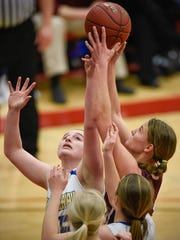 Cathedral's Julia Meyer (left) and Sauk Centre's Rebecca