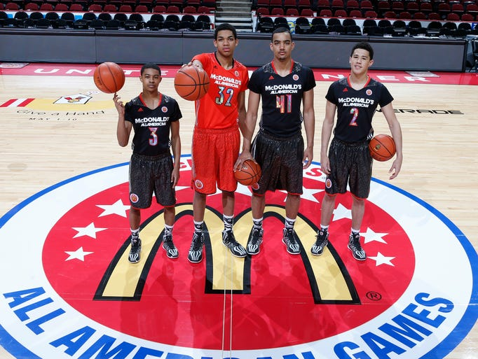 Apr 2, 2014; Chicago, IL, USA; McDonalds All Americans who will be attending University of Kentucky from left to right Tyler Ulis, Karl-Anthony Towns, Trey Lyles, and Devin Booker pose for a photo before the game at the United Center.