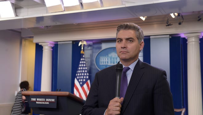 Jim Acosta of CNN waits to do a live shot following the daily briefing at the White House in Washington, Wednesday, Aug. 2, 2017. (AP Photo/Susan Walsh)