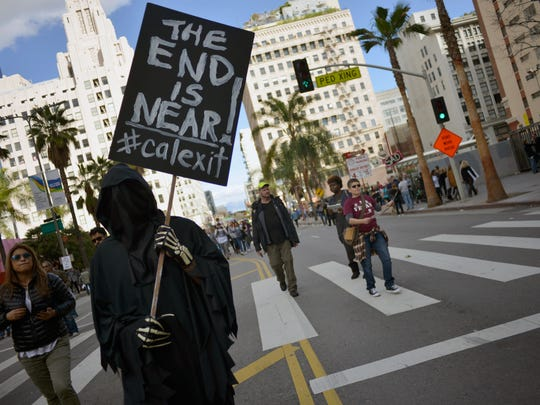 A participant holds a 'Calexit' sign during the Women's March on Jan. 21, 2017 in Los Angeles.