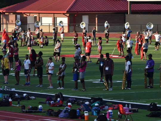 Several students in the Clinton High School band practice