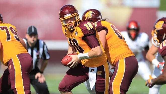 Central Michigan quarterback Cooper Rush looks to hand off against UNLV on Sept. 17, 2016, in Mount Pleasant.