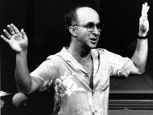 """In this July 28, 1986 file photo, bandleader Paul Shaffer directs his band during a rehearsal for """"Late Night with David Letterman"""" in New York. Shaffer, now 65, has been the gravel-voiced sidekick of David Letterman since 1982. Letterman is retiring on May 20."""