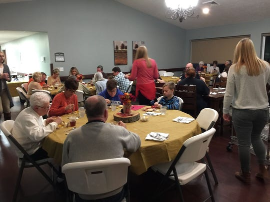 Residents and their families enjoy the annual Thanksgiving dinner.