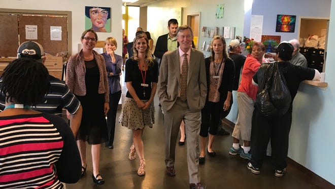 Gov. John Hickenlooper, center, tours the The Sister Mary Alice Murphy Center for Hope during a stop in Fort Collins on Wednesday, Sept. 13.