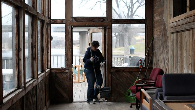 A member of the San Angelo Clubhouse helps clean up the old Float 404 Tapas Bar building on South Irving Street. The clubhouse offers adults with mental illness a chance to build their work skills and social relationships.