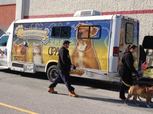Vaccinations and microchipping are performed inside the CPAA mobile van in the parking lot