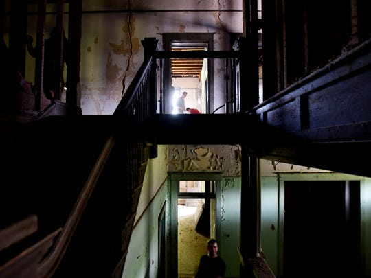 The main staircase inside the Bridges-McKellar Mansion. Built in 1885 for the wife of a man who would become a Shreveport mayor, it now stands in a state of abandonment but efforts are being made to help preserve the historic mansion.