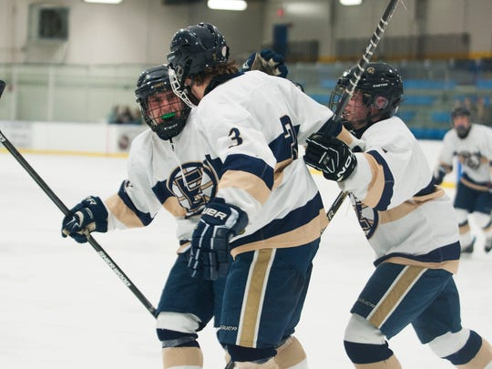 Essex celebrates a goal during the boys hockey game between the Spaulding Crimson Tide and the Essex Hornets at Essex high school on Wednesday night January 7, 2015 in Essex, Vermont. (BRIAN JENKINS, for the Free Press)