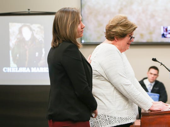 Donna Markham cries as she talks about her late daughter Chelsea, a victim of former gymnastics doctor Larry Nassar.  Chelsea committed suicide in 2009.