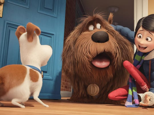 """In this image released by Universal Pictures, from left, characters Max, voiced by Louis C.K., Duke, voiced by Eric Stonestreet, and Katie, voiced by Ellie Kemper, appear in a scene from, """"The Secret Lives of Pets."""" (Illumination Entertainment and Universal Pictures via AP)"""