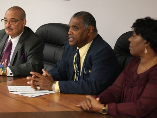 Eugene Rudder (from left) on Monday attends a press