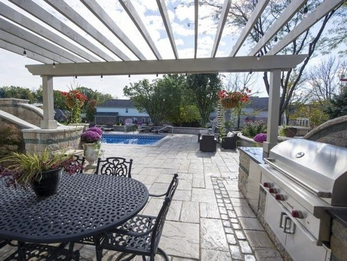 Paul and Peggy Jacobs created 2,000 square feet of outdoor living space for their home in the Franklin Township Greystone neighborhood.   The outdoor kitchen features a Wolf gas grill, a FireMagic refrigerator and a storage and trash bin. The granite countertop was installed by Santorini Brothers. The home's upper deck has a small Weber grill the family uses for quick outdoor meals.   The outdoor living space was designed and built by Brian Budde of Budde Landscaping, Inc.  By Deb Buehler, Star correspondent