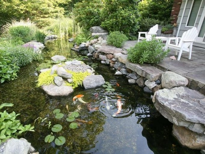Photos ponds and waterfalls every garden can use some h2o for Recirculating water feature