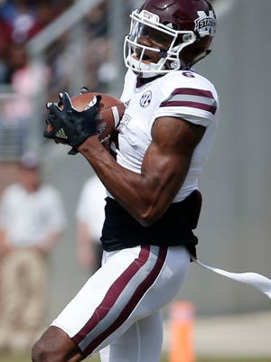 White wide receiver Jamal Couch cradles the ball after catching a pass during the first half of Mississippi State's Maroon and White spring NCAA college football game Saturday, April 21, 2018, in Starkville, Miss. (AP Photo/Rogelio V. Solis)