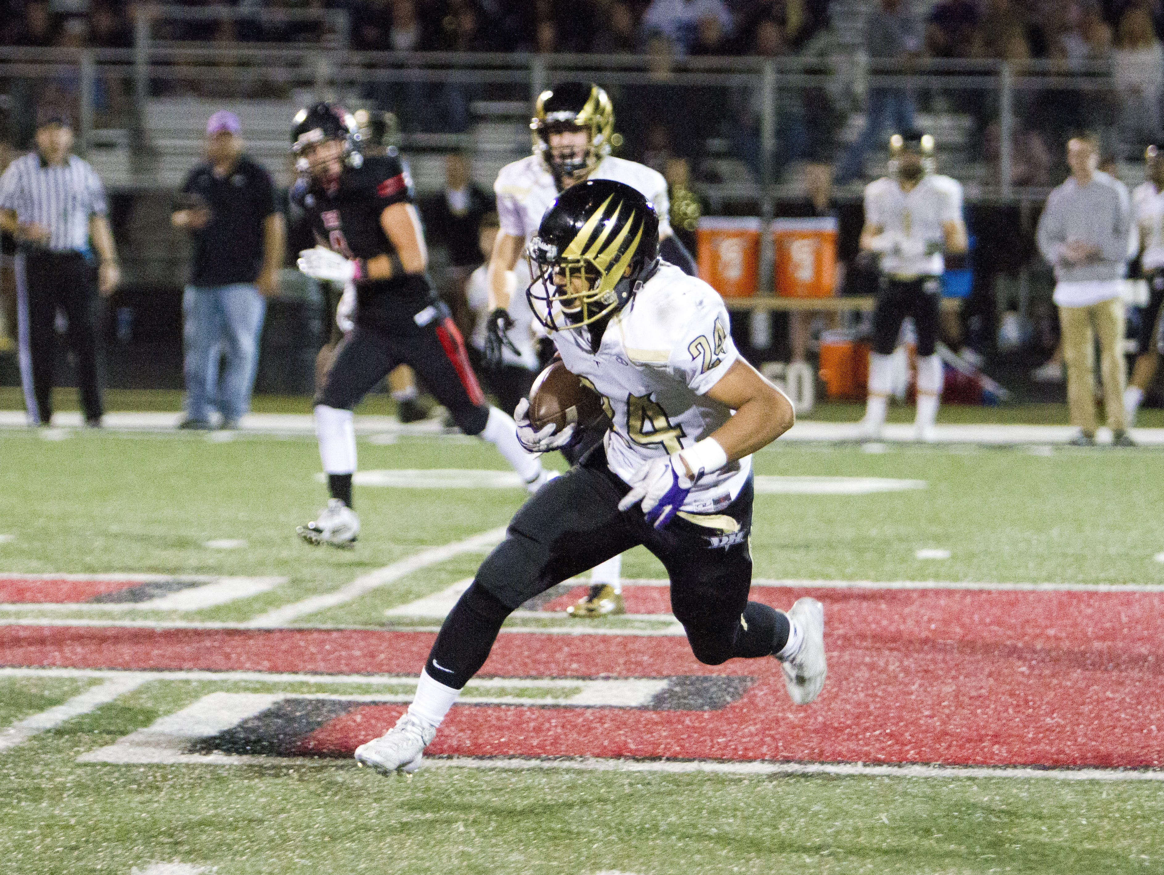 Desert Hills' Nephi Sewell scores a touchdown against Hurricane Friday, Oct. 24, 2014. Desert Hills looks to rebound after a disappointing season last year and is one of the favorites to win the state 3AA title.