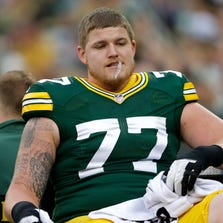 Green Bay Packers' Aaron Adams is carted off the field after getting injured in the first quarter.